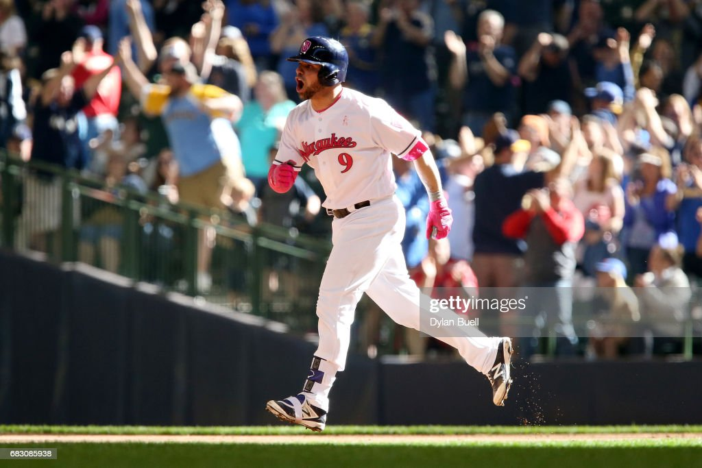 Manny Pina #9 of the Milwaukee Brewers reacts after hitting a home run in the eighth inning against the New York Mets at Miller Park on May 14, 2017 in Milwaukee, Wisconsin. Players are wearing pink to celebrate Mother's Day weekend and support breast cancer awareness.