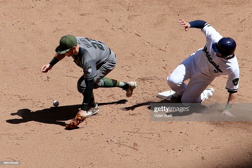 Manny Pina #9 of the Milwaukee Brewers slides into second base past Brandon Drury #27 of the Arizona Diamondbacks in the fifth inning at Miller Park on May 28, 2017 in Milwaukee, Wisconsin.