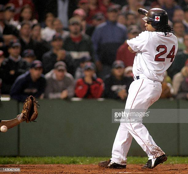 Manny Ramirez is hit by a pitch from Oakland's Keiichi Yabu with bases loaded walking home the winning run in the 10th inning