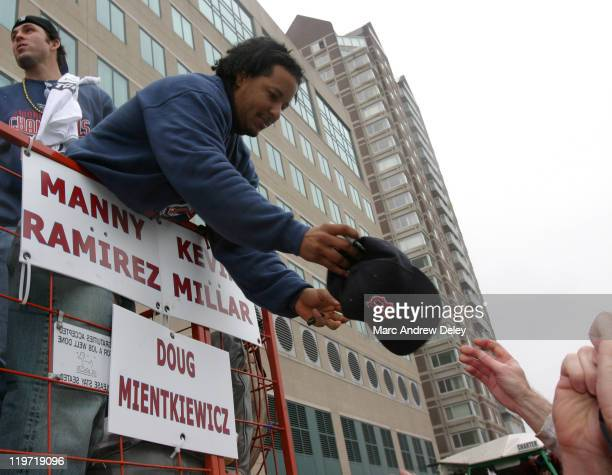Manny Ramirez of the Boston Red Sox and World Series MVP signs autographs during the Rolling Rally parade held in honor of the Red Sox World Series...