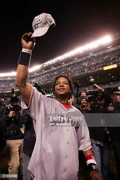 Manny Ramirez of the Boston Red Sox celebrates after defeating the New York Yankees 103 to win game seven of the American League Championship Series...