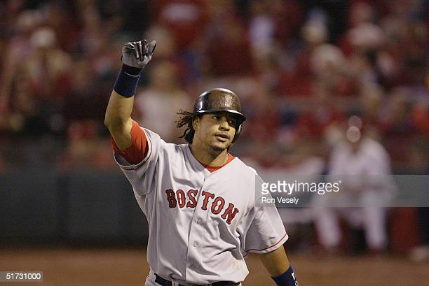 Manny Ramirez of the Boston Red Sox celebrates after hitting a home run in the first inning during game three of the 2004 World Series against the...