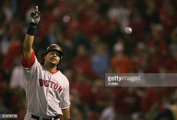 Manny Ramirez of the Boston Red Sox celebrates after hitting a solo home run in the first inning during game three of the World Series against the...