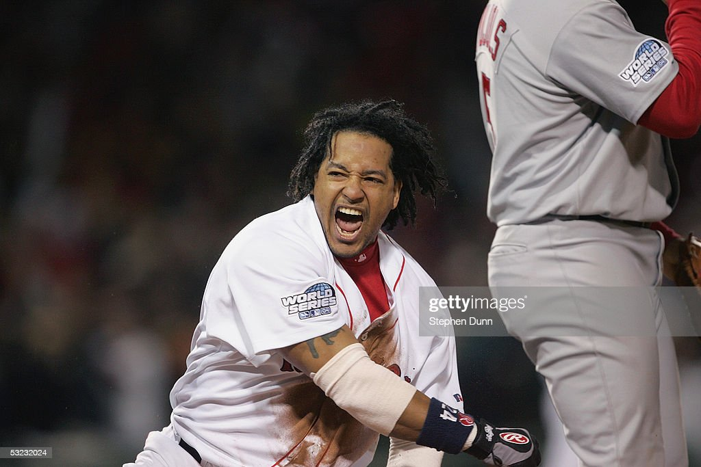Manny Ramirez #24 of the Boston Red Sox celebrates during game one of the 2004 World Series against the St. Louis Cardinals on October 23, 2004 at Fenway Park in Boston, Massachusetts.