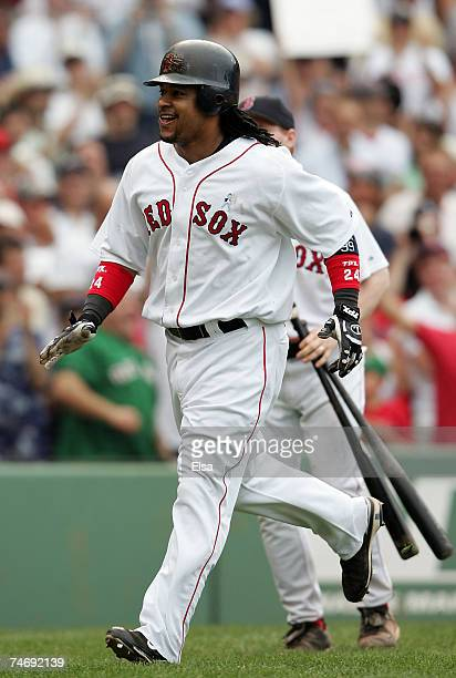 Manny Ramirez of the Boston Red Sox celebrates his solo home run in the seventh inning against the San Francisco Giants on June 17 2007 at Fenway...