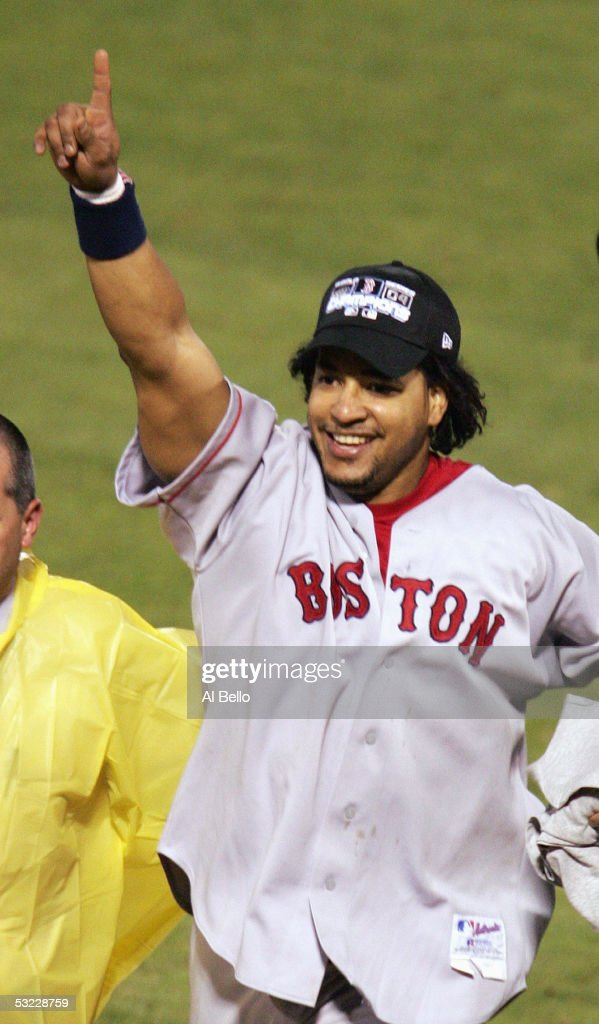 Manny Ramirez #24 of the Boston Red Sox celebrates the victory over the St. Louis Cardinals in game four of the World Series on October 27, 2004 at Busch Stadium in St. Louis, Missouri. The Red Sox defeated the Cardinals 3-0 to win the World Series 4-0.