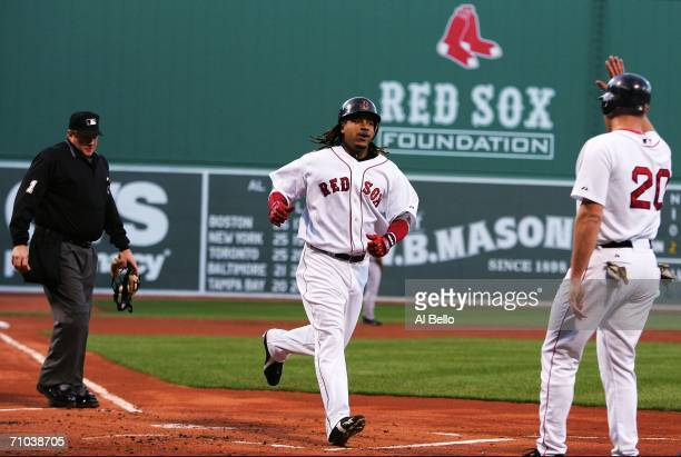 Manny Ramirez of the Boston Red Sox celebrates with Kevin Youkilis his two run home run in the first inning against Randy Johnson of the New York...