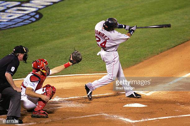 Manny Ramirez of the Boston Red Sox hits a home run during the first inning of game three of the 2004 World Series against the St. Louis Cardinals at...