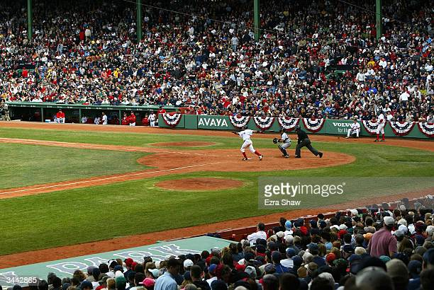 Manny Ramirez of the Boston Red Sox hits a long fly ball during their game against the New York Yankees in the 5th inning on April 18 2004 at Fenway...