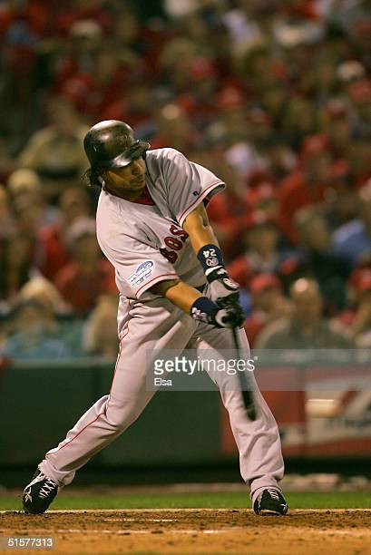 Manny Ramirez of the Boston Red Sox hits a RBI single in the fifth inning against the St Louis Cardinals during game three of the World Series on...