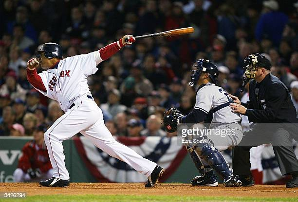 Manny Ramirez of the Boston Red Sox hits a solo home run in the first inning against starting pitcher Javier Vazquez of the New York Yankees on April...