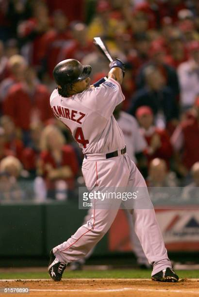 Manny Ramirez of the Boston Red Sox hits a solo home run in the first inning against the St Louis Cardinals during game three of the World Series on...