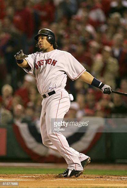 Manny Ramirez of the Boston Red Sox hits a solo home run in the first inning during game three of the World Series against the St Louis Cardinals on...
