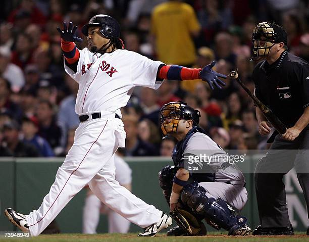 Manny Ramirez of the Boston Red Sox hits a solo home run in the third inning against the New York Yankees on April 22, 2007 at Fenway Park in Boston,...