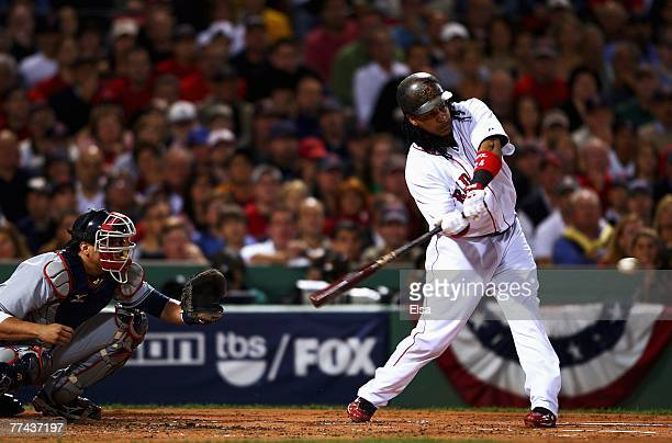 Manny Ramirez of the Boston Red Sox hits an RBI single in the first inning against the Cleveland Indians in Game Seven of the American League...
