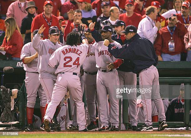 Manny Ramirez of the Boston Red Sox is congratulated by his teammates after hitting a solo home run in the first inning against the St Louis...