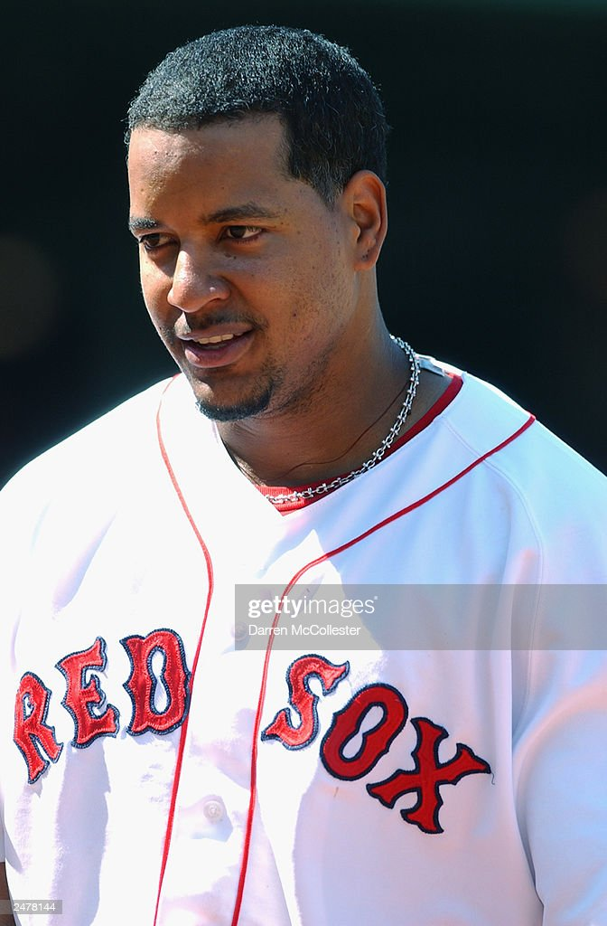 Manny Ramirez #24 of the Boston Red Sox looks on during the MLB game against the Seattle Mariners at Fenway Park August 23, 2003 in Boston, Massachusetts The Red Sox defeated the Mariners 7-6.