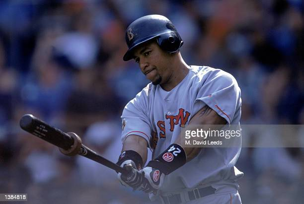 Manny Ramirez of the Boston Red Sox makes a practice swing during the game against the New York Yankees on September 8 2001 at Yankee Stadium in...