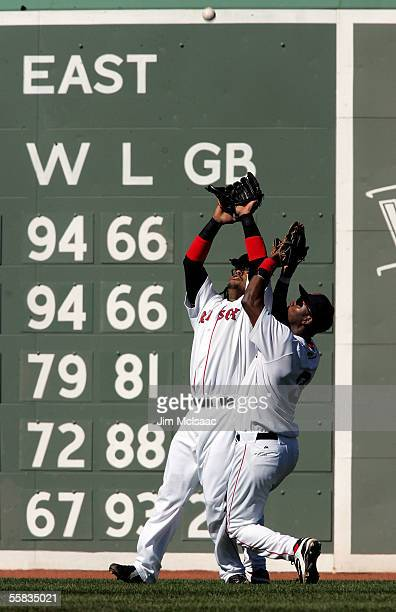 Manny Ramirez of the Boston Red Sox makes the catch nearly colliding with teammate Edgar Renteria in the second inning against the New York Yankees...