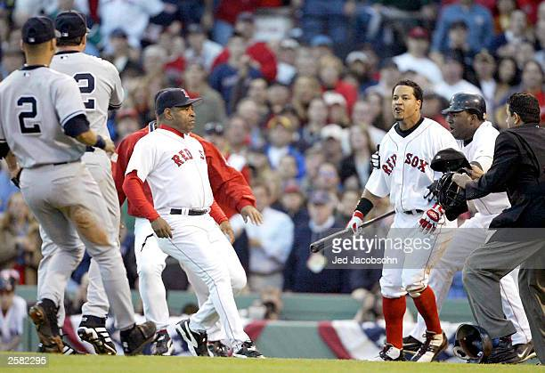 Manny Ramirez of the Boston Red Sox reacts after a pitch by Roger Clemens of the New York Yankees during the fourth inning of Game 3 of the 2003...