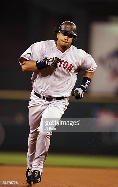 Manny Ramirez of the Boston Red Sox rounds the bases after hitting a solo home run in the first inning during game three of the World Series against...