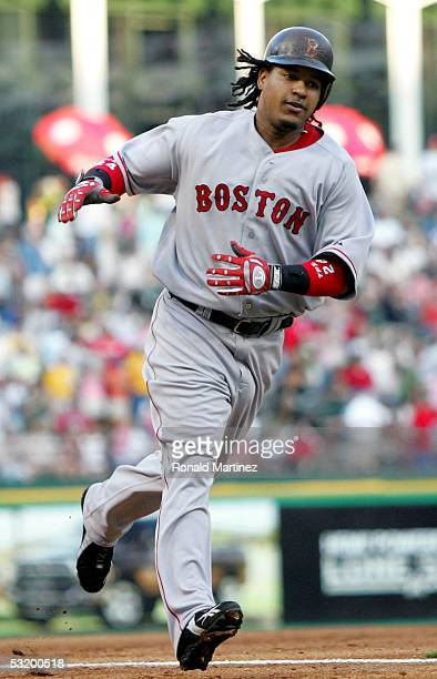 Manny Ramirez of the Boston Red Sox rounds third base after hitting a grand slam in the third inning against the Texas Rangers on July 5, 2005 at...