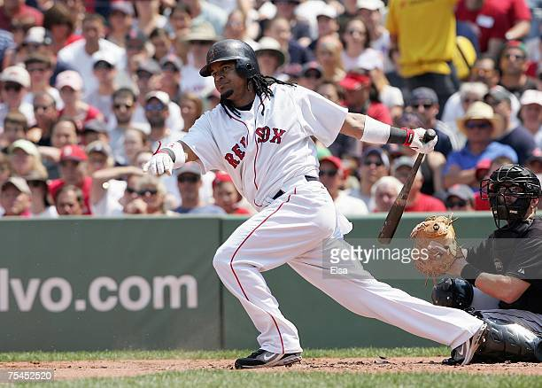 Manny Ramirez of the Boston Red Sox swings at the pitch during the game against the Toronto Blue Jays on July 15 2007 at Fenway Park in Boston...