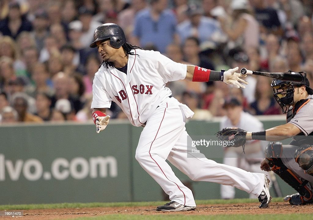 Manny Ramirez #24 of the Boston Red Sox swings at the pitch during the game against the Baltimore Orioles on July 31, 2007 at Fenway Park in Boston, Massachusetts.