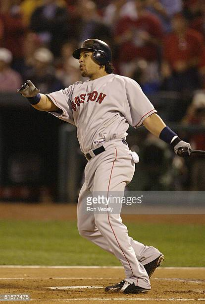 Manny Ramirez of the Boston Red Sox watches his home run during the first inning of game three of the 2004 World Series against the St. Louis...