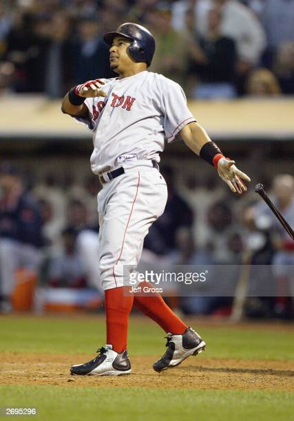 Manny Ramirez of the Boston Red Sox watches the ball leave the yard for a threerun home run against the Oakland A's during the sixth inning of Game 5...