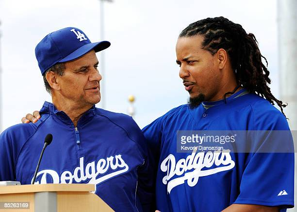 Manny Ramirez of the Los Angeles Dodgers and manager Joe Torre speak during a news conference on March 5 at Camelback Ranch in Glendale Arizona...