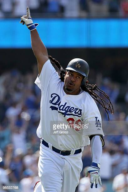 Manny Ramirez of the Los Angeles Dodgers celebrates after hitting a tworun homerun in the eighth inning against the San Francisco Giants at Dodger...
