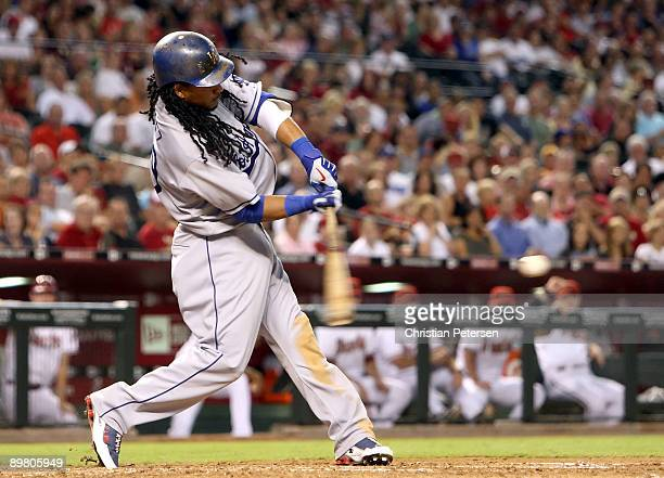 Manny Ramirez of the Los Angeles Dodgers hits a single against the Arizona Diamondbacks during the major league baseball game at Chase Field on...