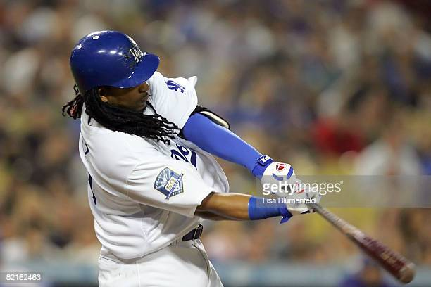 Manny Ramirez of the Los Angeles Dodgers hits a single in the sixth inning against the Arizona Diamondbacks at Dodger Stadium on August 2, 2008 in...
