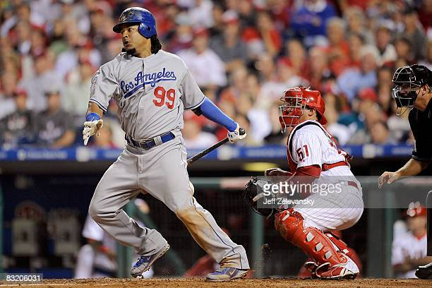 Manny Ramirez of the Los Angeles Dodgers hits a single in the top of the fifth inning against the Philadelphia Phillies in Game One of the National...
