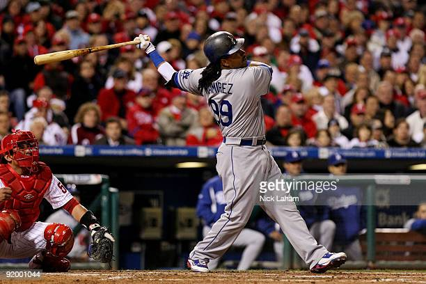 Manny Ramirez of the Los Angeles Dodgers hits a single in the top of the fourth inning against the Philadelphia Phillies in Game Four of the NLCS...