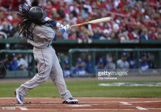 Manny Ramirez of the Los Angeles Dodgers hits an RBI double against the St Louis to score Matt Kemp in the first inning of Game Three of the NLDS...