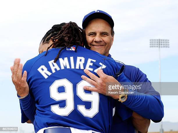 Manny Ramirez of the Los Angeles Dodgers hugs manager Joe Torre during a news conference on March 5 at Camelback Ranch in Glendale Arizona after he...