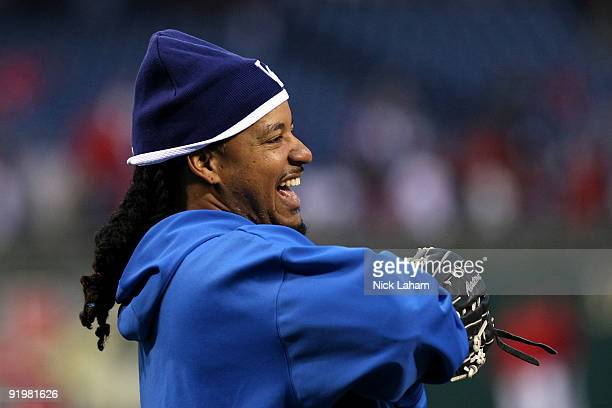 Manny Ramirez of the Los Angeles Dodgers laughs during batting practice against of the Philadelphia Phillies in Game Three of the NLCS during the...