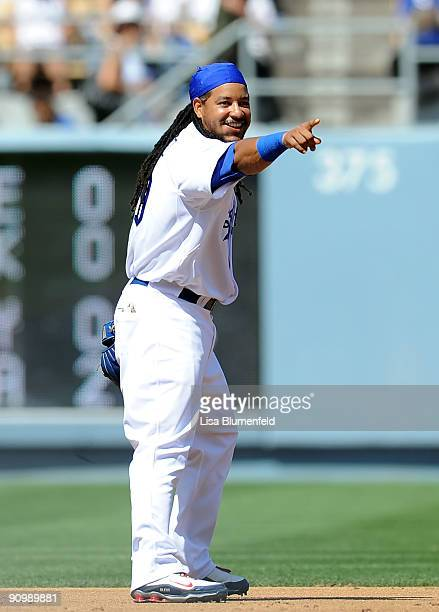 Manny Ramirez of the Los Angeles Dodgers points to the Giants dugout during the game against the San Francisco Giants at Dodger Stadium on September...