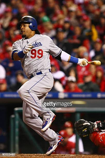 Manny Ramirez of the Los Angeles Dodgers reacts as he fouls a ball off of his foot in the top of the sixth inning against of the Philadelphia...