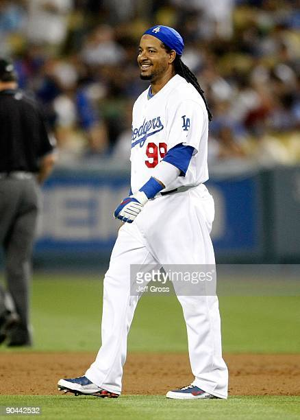 Manny Ramirez of the Los Angeles Dodgers smiles as he walks to the outfield against the Arizona Diamondbacks at Dodger Stadium on September 1 2009 in...