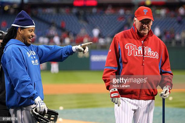 Manny Ramirez of the Los Angeles Dodgers talks with manager Charlie Manuel of the Philadelphia Phillies during batting practice prior to Game Three...
