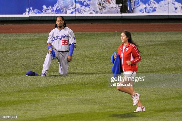 Manny Ramirez of the Los Angeles Dodgers watches a ball girl run by in the eighth inning of Game Two of the National League Championship Series...