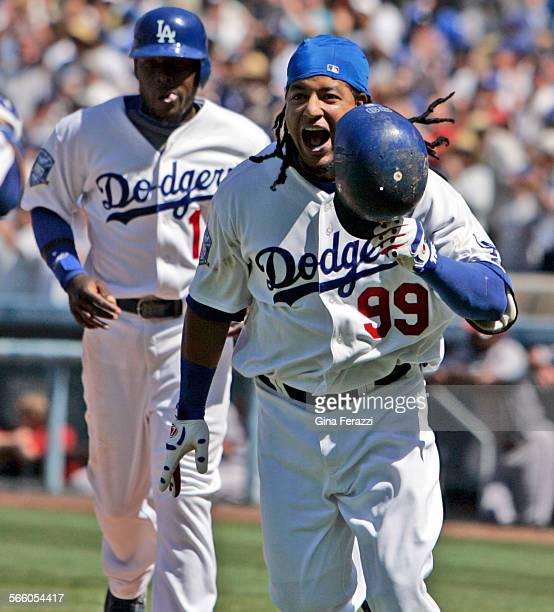 Manny Ramirez reacts as he crosses home plate after hitting a 3–run homerun against the Arizona Diamondbacks in the 5th inning at Dodger Stadium in...
