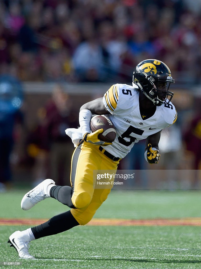 Manny Rugamba #5 of Iowa carries the ball after catching an interception against Minnesota during the second quarter of the game on October 8, 2016 at TCF Bank Stadium in Minneapolis, Minnesota.