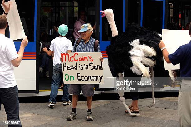 OSTRICH Manny Salzman holding sign and his daughter Naomi in the ostrich costume protested with a handful of others affilliated with the group...
