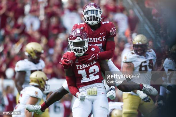 Manny Walker and Yvandy Rigby of the Temple Owls celebrate a defensive stop against the Boston College Eagles at Lincoln Financial Field on September...