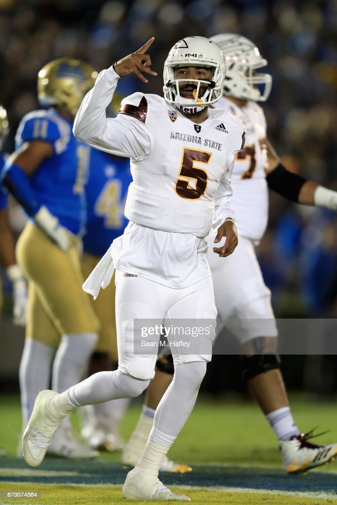 Manny Wilkins #5 of the Arizona State Sun Devils reacts to scoring a touchdown during the first half of a game against the UCLA Bruins at the Rose Bowl on November 11, 2017 in Pasadena, California.
