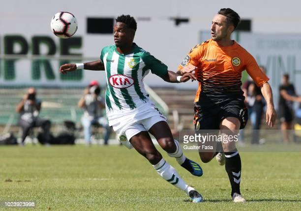 Mano of Vitoria FC with Joao Camacho of CD Nacional in action during the Liga NOS match between Vitoria FC and CD Nacional at Estadio do Bonfim on...